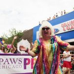 Female impersonator Miss Foozie leads a group of marchers raising awareness for animal welfare.