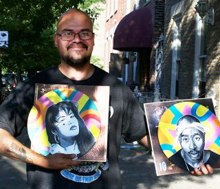"Ricardo ""Naco"" Gonzalez holds two of his new vinyl portraits."