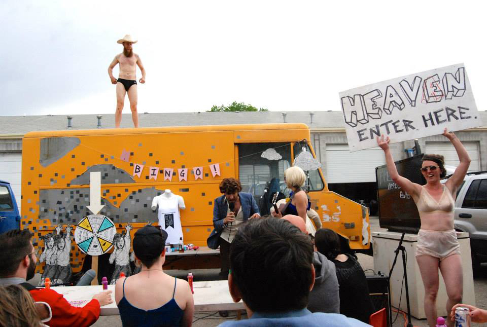 "Shane ""Coachaine"" Rooney dances atop the RealGood art truck as a performance art bingo game takes place at VonCommon's annual PromCommon festival."