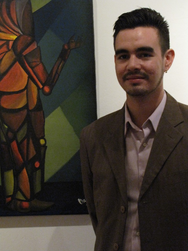Funes standing next to artwork in Artefacto. Photo by Danielle Mackey.