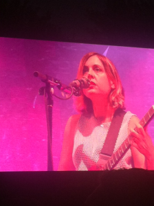 Corin Tucker singing and shredding at the same time.