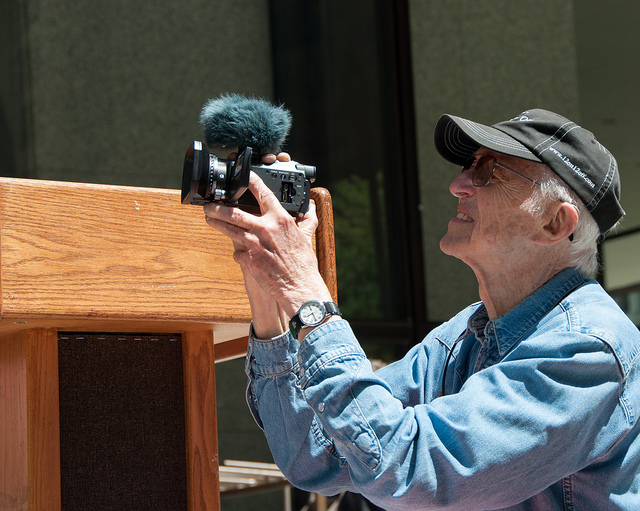 Haskell Wexler covering Occupy Chicago Foreclosure Moratoriun protest. Photo Courtesy of Steve Rhodes on Flickr, 2012